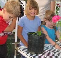 School kids in a Solexx Conservatory greenhouse